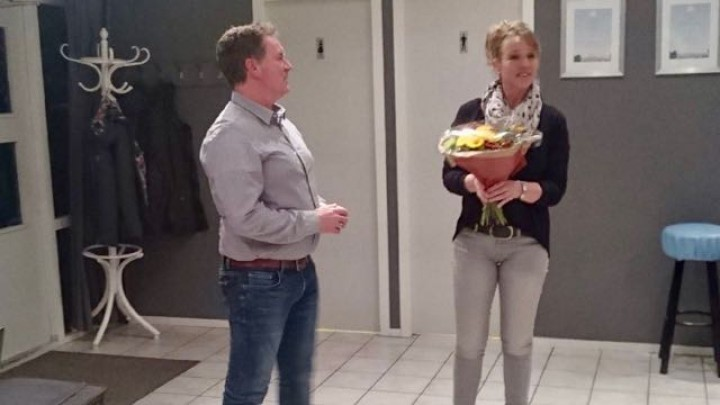 Bloemen en een toespraak voor de vertrekkende Wim Nieuwland.